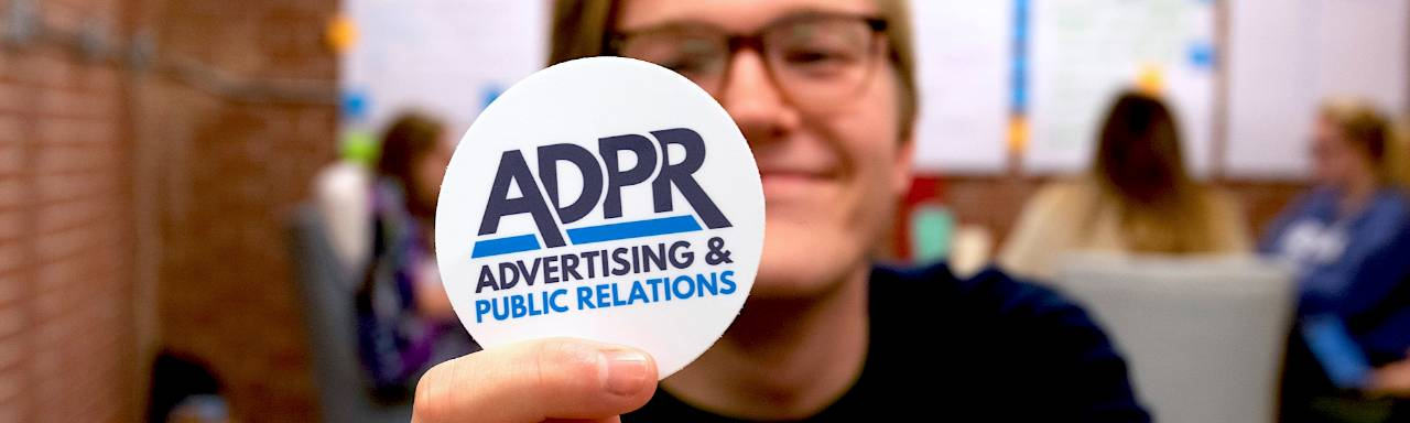 GVSU Student holds up ADPR button
